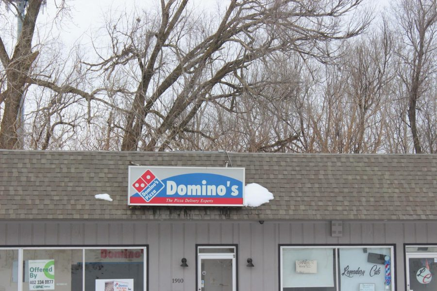 """In the """"Paving for Pizza"""" program, Dominoes handed over cash to many cities across America to repair potholes and cracks and then later spray painted their logo on some of the new smoothed streets. """"Dominoes developed the program because there's nothing worse than hitting a pothole - you instantly cringe,"""" Bulger Said."""