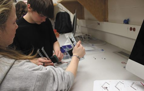"Clink! While at a meeting for Robotics Club freshman Fianna Glenn and Robert Raffety prepare their robot for competition.""The hardest part is planning, after that you have to assemble and program which takes one to two months."""