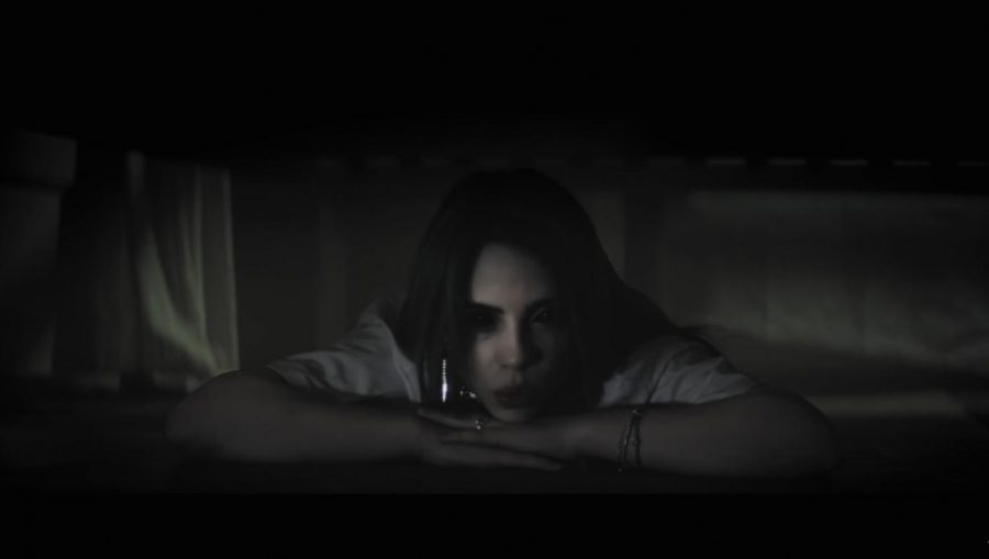 "In her music video, ""bury a friend"" Billie Eilish is representing the monster she faces within herself. ""When we made 'bury a friend,' the whole album clicked in my head,"" said. ""I immediately knew what it was going to be about, what the visuals were going to be, and everything in terms of how I wanted it to be perceived. It inspired what the album is about. 'bury a friend' is literally from the perspective of the monster under my bed."" Image from Billie Eilish's video courtesy of Moxie."