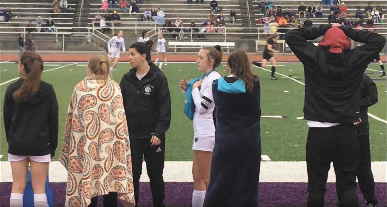 """During the girls varsity game against West, head girls soccer coach Sara Fjell looks for senior Nydia Clarke to sub into the game. """"You kind of try to match up your personnel with your opponent's personnel,"""" Fjell said. """"The goal is to have everyone playing at the same high level on the field so as long as we can kind of eliminate some of those small weaknesses along the way."""" Photo by Diego Vasquez Glover"""