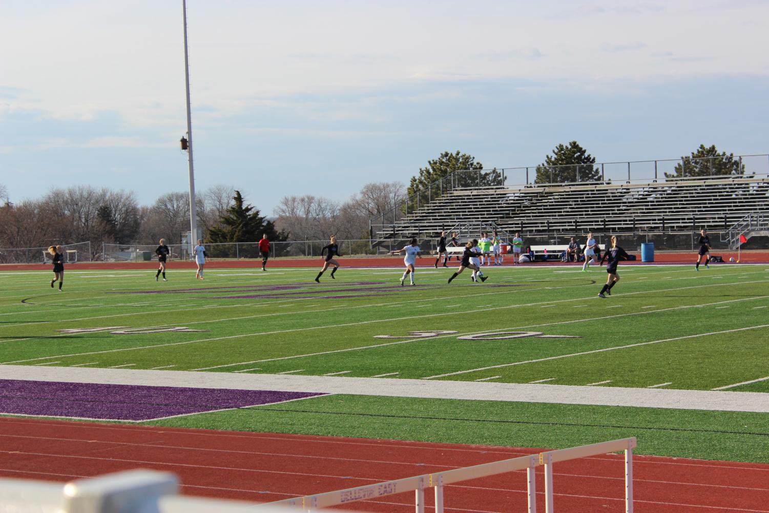Sophomore Sami Redding heads down the field to attempt to score. Photo by Sharon Guchu