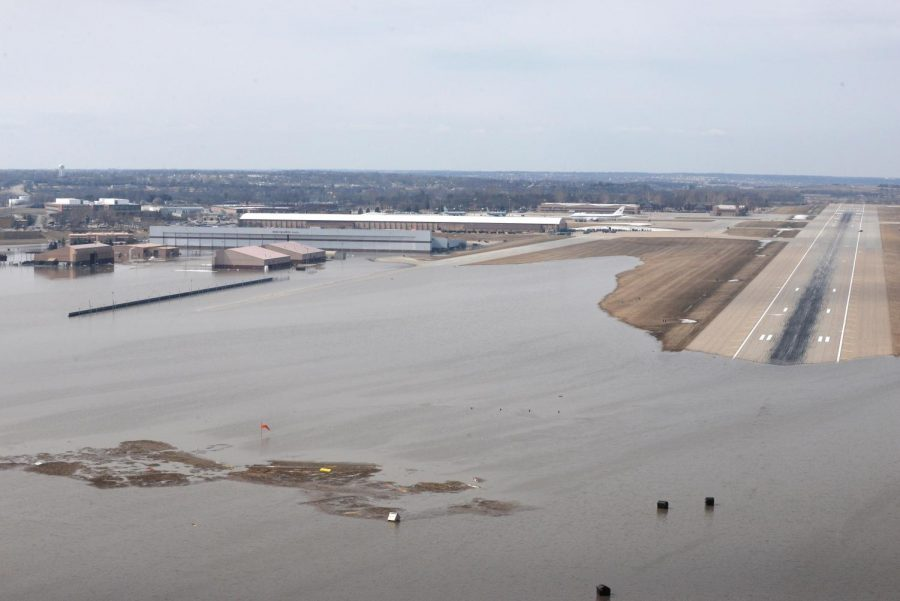 An aerial view of Offutt Air Force Base and the surrounding areas affected by flood waters Mar. 17. Increased water levels in many rivers and waterways were caused by the most amount of snowfall over this past winter. In addition, a large drop in air pressure caused massive amounts of flooding across the state of Nebraska. Due to this, many families in Nebraska have lost their homes, as well as many precious valuables. Many organizations have donated their time, effort and money to help these people. Photo courtesy of  U.S Air Force TSgt. Rachelle Blake