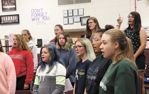 """Belle Voix students warm up their voices. Belle Viox is a varsity womens choir new to Bellevue East. """"I joined because I thought it was something new and I felt like it was going to be fun,"""" junior Abbie Jackson said. Photo by Cora Bennett"""
