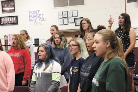 "Belle Voix students warm up their voices. Belle Viox is a varsity womens choir new to Bellevue East. ""I joined because I thought it was something new and I felt like it was going to be fun,"" junior Abbie Jackson said. Photo by Cora Bennett"