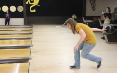 "Senior Alec Welte gets into his bowling stance. The unified bowling team practiced Tuesdays after school at Leopard Lanes. ""It's just something I like to do for fun; it isn't that challenging. I have been doing it for quite a while now,"" Welte said. Photo by Cora Bennet"