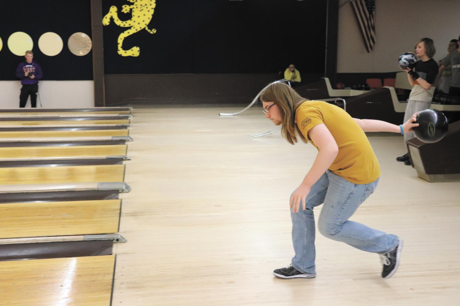 """Senior Alec Welte gets into his bowling stance. The unified bowling team practiced Tuesdays after school at Leopard Lanes. """"It's just something I like to do for fun; it isn't that challenging. I have been doing it for quite a while now,"""" Welte said. Photo by Cora Bennet"""
