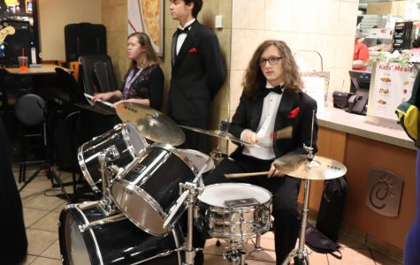 "Junior Christpher Moore plays the drumset. ""Chick-Fil-A night is a fun experience that helps the choir out a lot,it is also a huge fundraiser for us,"" Moore said. Photo by Cora Bennett"
