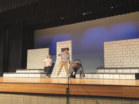 "Senior Jonathon Ullom and senior Luke Muffitt play their role while battling it out in the One Act Play ""Hammered.""  ""Getting to have the hammer at the end of the show was pretty cool even if it did look stupid,"" Muffitt said. Photo by Mckenzie Gandy"