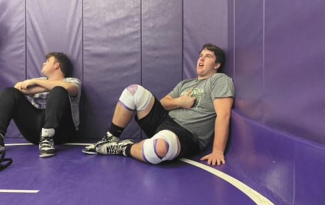 """Chatting it up with some teamates, junior Preston Welch prepares to start practice in his third year as a Chieftain wrestler. """"Last year's season was pretty good; we had 3 state medalist two of which were state champions and this year we are looking to build on that,"""" Welch said. Photo by Jacob Kriewald."""