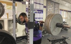 """Sophomore Gage Higgs lifts 405 pounds at his practice for the upcoming state meet. """"I'm only as good as my last broken record; I have been doing this for so long that powerlifting has become more than a sport to me - it's a lifestyle,"""" Higgs said."""