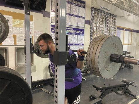 "Sophomore Gage Higgs lifts 405 pounds at his practice for the upcoming state meet. ""I'm only as good as my last broken record; I have been doing this for so long that powerlifting has become more than a sport to me - it's a lifestyle,"" Higgs said."